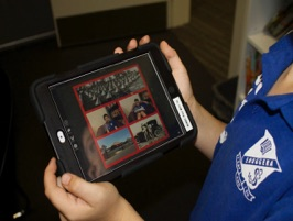 an image of student using a portable device