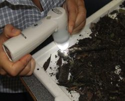 image of a student testing soil